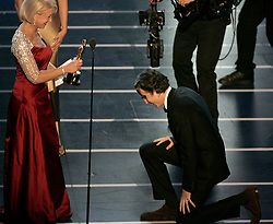 Feb. 24, 2008 - Actor Daniel Day-Lewis accepts the Oscar for Best actor for ''There Will Be Blood'' from presenter Helen Mirren during the 80th annual Academy Awards at the Kodak Theatre in Hollywood, California, Sunday, February 24, 2008. (Mindy Schauer/Orange County Register/MCT) (Credit Image: © Mindy Schauer/MCT/ZUMAPRESS.com)