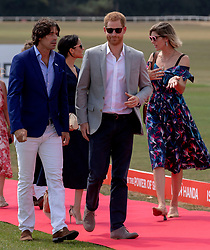 The Duke of Sussex and Nacho Figueras (left)arrive for the Sentebale ISPS Handa Polo Cup at the Royal County of Berkshire Polo Club in Windsor.