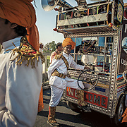 The wedding baaja band and their music show during a baraat procession. Udaipur 2010.