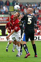 Photo: Dave Linney.<br />Walsall v Macclesfield Town. Coca Cola League 2. 16/09/2006.Martin Butler(L)battles for the ball with Danny Swailes