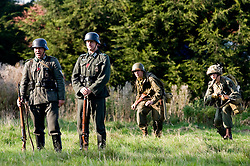 Reenactors portraying US Airborne troops sneak up on German sentries during a small scale Skirmish at the Northallerton Wartime weekend charity fundraiser for Help for Heros and Ben Hyde Memorial Trust 9th &10th Ocober 2010 .Images <br /> © Paul David Drabble