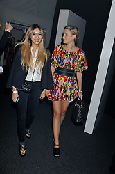 Left to right, ZARA MARTIN and AMBER ATHERTON at a party hosted by Rimmel London to celebrate the 10 year partnership with Kate Moss held at Battersea Power Station, London SW8 on 15th September 2011.
