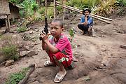 A boy with his toy gun