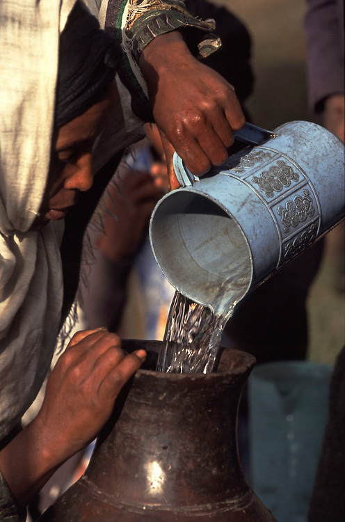 Ethiopia<br /> Woman pouring water into her water carrier from a well in the highlands of Ethiopia<br /> <br /> Pic Steve Morgan