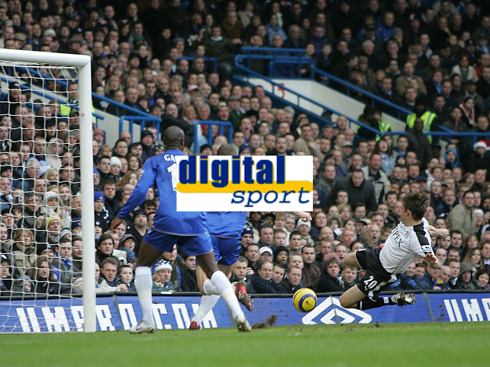 Photo: Lee Earle.<br /> Chelsea v Fulham. The Barclays Premiership. 26/12/2005. Fulham's Brian McBride (R) flings himself into the ball to score their first goal.