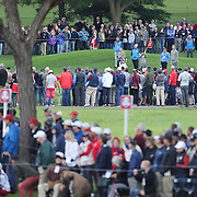 Ryder Cup 2016. Rory McIlroy of Europe plays his approach shot on the 16th during practice day in front of massive crowds at the Hazeltine National Golf Club on September 28, 2016 in Chaska, Minnesota.  (Photo by Tim Clayton/Corbis via Getty Images)