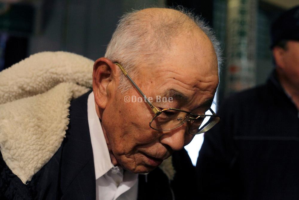 portrait of an Asian elderly man during a walk