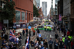 © Licensed to London News Pictures. 31/08/2019. Manchester, UK. A view of Deansgate blocked and closed to traffic . Extinction Rebellion block roads in Manchester City Centre during four days of planned disruption organised by environmental campaigners . Manchester City Council has declared a climate emergency but activists say the council's development plans do not reflect this . Photo credit: Joel Goodman/LNP