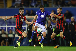 Birmingham City's Lukas Jutkiewicz (left) AFC Bournemouth's Dan Gosling (right) battle for the ball during the Carabao Cup, Second Round match at St Andrew's, Birmingham.