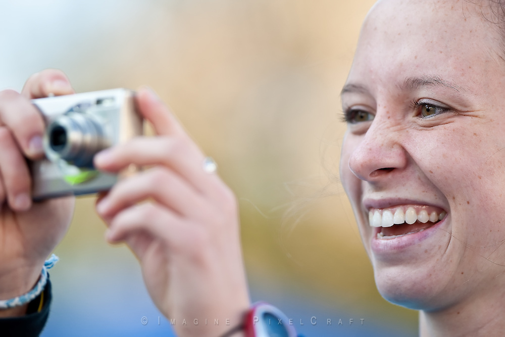 A spectator enjoys taking a photo at the Quad Cities Marathon in 2009.