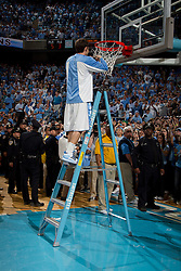 CHAPEL HILL, NC - MARCH 05: Van Hatchell #13 of the North Carolina Tar Heels cuts down the net after defeating the Duke Blue Devils and winning the regular season ACC championship on March 05, 2011 at the Dean E. Smith Center in Chapel Hill, North Carolina. North Carolina won 67-81. (Photo by Peyton Williams/UNC/Getty Images) *** Local Caption *** Van Hatchell