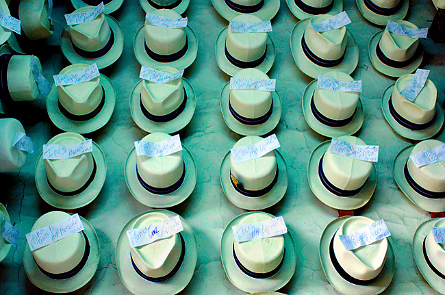 Refurbished Panama hats wait for their owners to be picked up at a hat store in Cuenca, Ecuador.  The Panama hat originated in Ecuador.