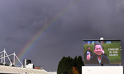 A rainbow over a screen showing Leicester City Chairman Vichai Srivaddhanaprabha ahead of the Premier League match at the King Power Stadium, Leicester.
