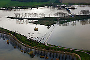 Nederland, Limburg, Gemeente Maasgouw, 15-11-2010; Hoogwater in de Maas met Stuw van Linne, met waterkrachtcentrale naast de stuw. Onder in beeld de Overlaat van Linne met een oude Maasarm. .Rising water at river Meuse, with Linne Spillway with hydroelectric plant. At the bottom Linne Spillway with an old branch of river Meuse. .luchtfoto (toeslag), aerial photo (additional fee required).foto/photo Siebe Swart