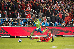 December 9, 2017 - Toronto, Ontario, Canada - Seattle Sounders defender KELVIN LEERDAM (18) jumps over a sliding Toronto FC defender JUSTIN MORROW (2) during the MLS Cup championship match at BMO Field in Toronto, Canada.  Toronto FC defeats Seattle Sounders 2 to 0. (Credit Image: © Mark Smith via ZUMA Wire)