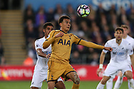 Dele Alli of Tottenham Hotspur is challenged by Kyle Naughton of Swansea city. Premier league match, Swansea city v Tottenham Hotspur  at the Liberty Stadium in Swansea, South Wales on Wednesday 5th April 2017.<br /> pic by Andrew Orchard, Andrew Orchard sports photography.
