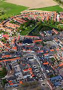 Nederland, Zeeland, Gemeente Sluis, 09-05-2013;  Oostburg, hoofdplaats van de gemeente Sluis. In de voorgrond de Markt, in de achtergrond de Kroonwijk met gereconstrueerd bastion.<br /> Oostburg is tijdens de Tweede Wereldoorlog zwaar beschadigd en vrijwel geheel herbouwd (naoorlogs wederopbouwgebied). <br /> The village of Oostburg (Zeeland) is heavily damaged during World War II and almost completely rebuilt. A reconstructed bastion in the park. <br /> luchtfoto (toeslag op standard tarieven);<br /> aerial photo (additional fee required);<br /> copyright foto/photo Siebe Swart.
