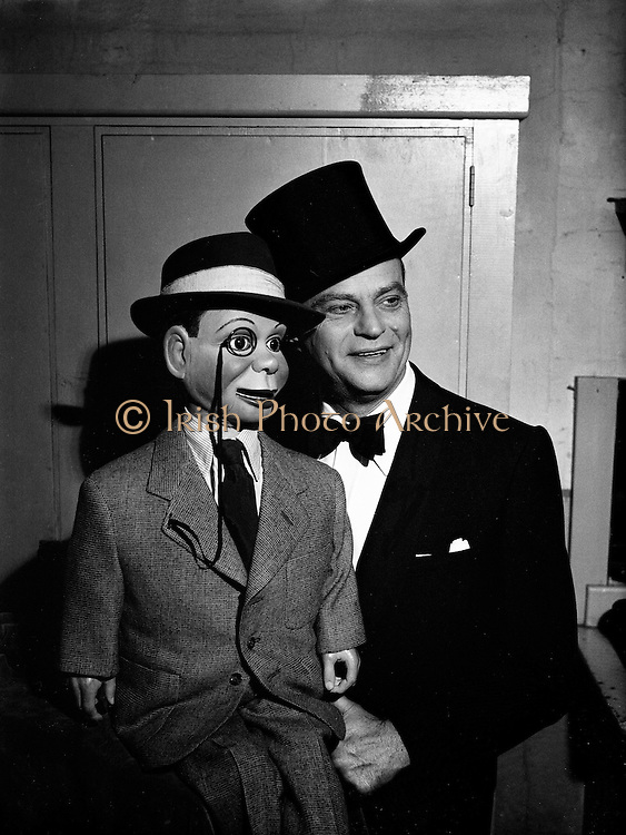 DOMAS Special Premier Taylors 'Charlie McCarthy' (Edgar Bergen).29/05/1953..Edgar John Bergen (February 16, 1903 - September 30, 1978) was an American actor and radio performer, best known as a ventriloquist...Charlie McCarthy is Edgar Bergen's famed ventriloquist dummy partner. Charlie was part of Bergen's act as early as high school, and by 1930, was attired in his famous top hat, tuxedo, and monocle. Charlie's personality was that of a mischievous little boy (with an Irish lilt), who could crack wise, misbehave, and flirt shamelessly in a way that Bergen couldn't (much the same way that the Muppet characters behaved more outrageously than any of their human co-stars). The original McCarthy dummy was built by noted carpenter/dummy-maker Theodore Mack, and was later rebuilt by Frank Marshall...