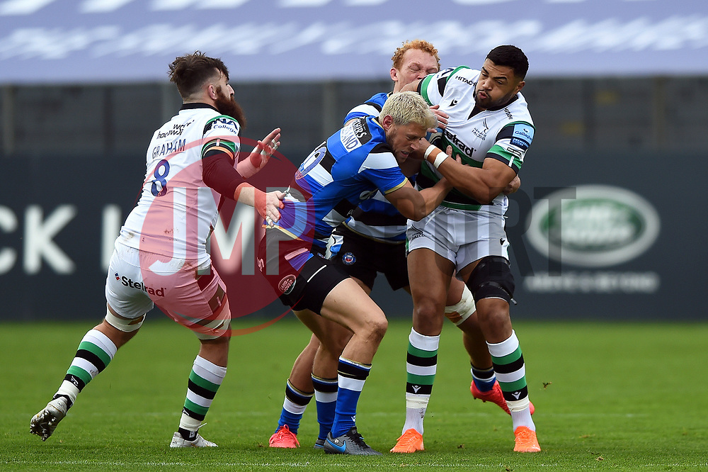 Luther Burrell of Newcastle Falcons is tackled by Rhys Priestland of Bath Rugby - Mandatory byline: Patrick Khachfe/JMP - 07966 386802 - 21/11/2020 - RUGBY UNION - The Recreation Ground - Bath, England - Bath Rugby v Newcastle Falcons - Gallagher Premiership