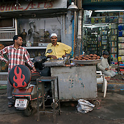 A man selling Phirni on the streets of Old Delhi, May 2007