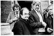 SALMAN RUSHDIE; GILLON AITKEN; JUST AFTER FATWA WAS ANNOUNCED. BRUCE CHATWIN MEMORIAL SERVICE. MOSCOW RD. LONDON. 14 FEBRUARY 1989. SUPPLIED FOR ONE-TIME USE ONLY> DO NOT ARCHIVE. © Copyright Photograph by Dafydd Jones 248 Clapham Rd.  London SW90PZ Tel 020 7820 0771 www.dafjones.com