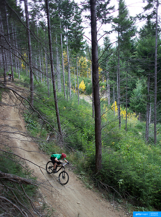 Mountain Bike racers tackle the Ben Lomond Forest course high above Queenstown during the Outside Sports Super D Enduro event in Queenstown, Central Otago, at the Weekend. The 6 hour non stop team and individual races attracted 86 competitors and included Skyline Gondola access.  The Open Female category was won by Hanna Thorne from Dunedin while Kurt Lancaster from Nelson won the Open Male Category. The event was part of the inaugural Queenstown Bike Festival, taking place from 16th-25th April. The event hopes to highlight Queenstown's growing profile as one of the three leading biking centres in the world. Queenstown, Central Otago, New Zealand. 16th April 2011. Photo Tim Clayton..