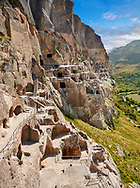Picture & image of Vardzia medieval cave city and monastery, Erusheti Mountain, southern Georgia (country)<br /> <br /> Inhabited from the 5th century BC, the first identifiable phase of building took place at  Vardzia in the reign of Giorgi III (1156-1184) to be continued by his successor, Queen Tamar 1186, when the Church of the Dormition was carved out of the rock and decorated with frescoes