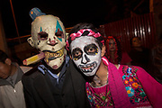 Costumed revelers parade during a comparsas or procession during the Day of the Dead Festival known in Spanish as Día de Muertos on November 2, 2013 in Atzompa Village, Oaxaca, Mexico.