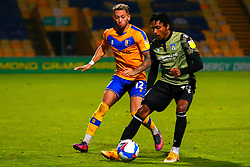 Kellan Gordon of Mansfield Town chases down Jevani Brown of Colchester United - Mandatory by-line: Ryan Crockett/JMP - 20/11/2020 - FOOTBALL - One Call Stadium - Mansfield, England - Mansfield Town v Colchester United - Sky Bet League Two
