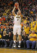 December 29 2010: Iowa Hawkeyes guard Matt Gatens (5) puts up a shot during the first half of an NCAA college basketball game at Carver-Hawkeye Arena in Iowa City, Iowa on December 29, 2010. Illinois defeated Iowa 87-77.