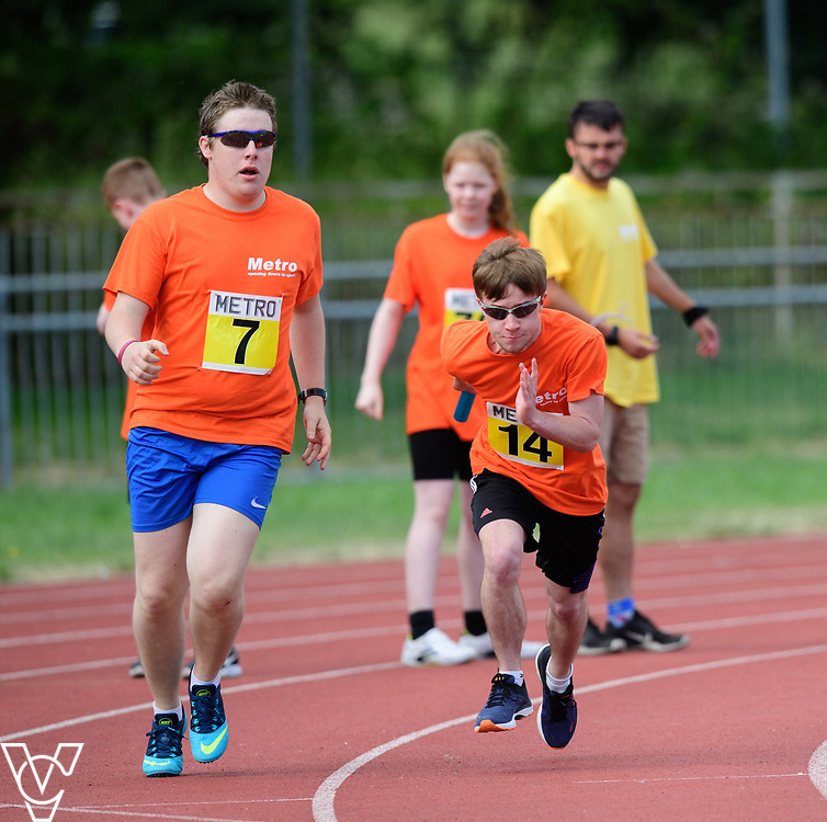 Event: 4x100 meter relay<br /> Competitors, from left: Matthew Boulding and Tom Barton<br /> <br /> Metro Blind Sport's 42nd Athletics Open, held at Mile End Stadium, Tower Hamlets, London.<br /> <br /> Picture: Chris Vaughan Photography for Metro Blind Sports<br /> Date: June 16, 2018