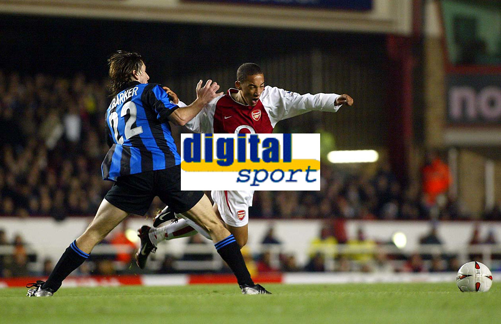 Photograph: Scott Heavey.<br />Arsenal v Rotherham United. Carling Cup Third Round.<br />Ryan Smith is tripped on the edge of the box by Shaun Barker
