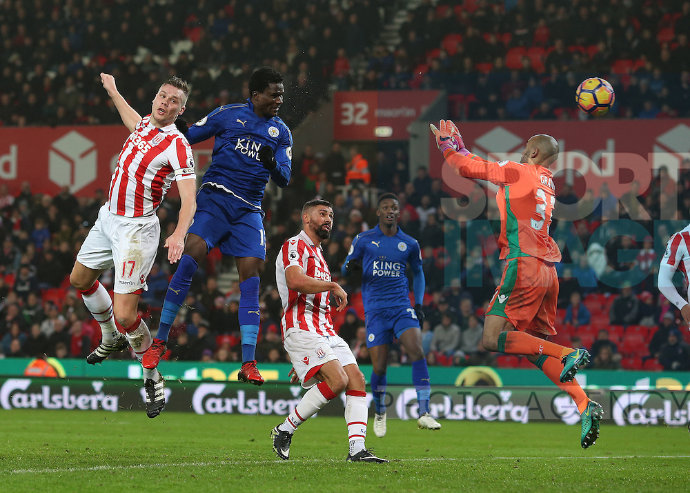 Daniel Amartey of Leicester City heads the equalising goal  past Lee Grant of Stoke City to earn 10 man Leicester a point during the English Premier League match at the Bet 365 Stadium, Stoke on Trent. Picture date: December 17th, 2016. Pic Simon Bellis/Sportimage