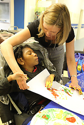 Girl doing painting at Mysight charity for people with visual impairments, Nottingham.