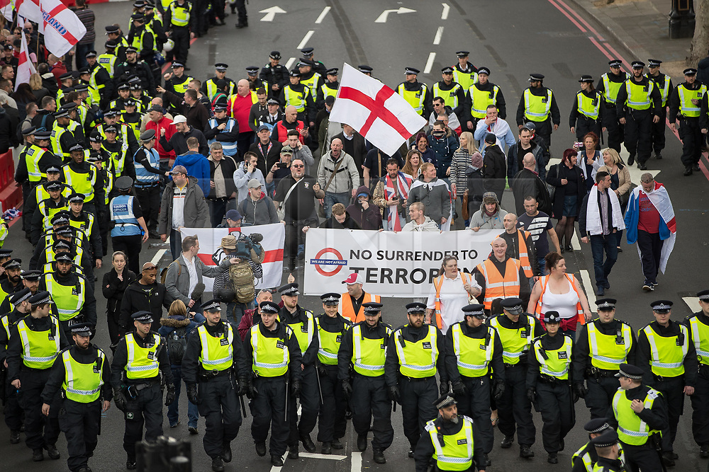 © Licensed to London News Pictures . 01/04/2017 . London , UK . The EDL demo passes along Victoria Embankment . The EDL and Britain First both hold demonstrations in London , opposed by anti-fascist groups , including Unite Against Fascism . Photo credit : Joel Goodman/LNP