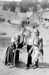 """File photo dated 30/07/58 of (left to right) Janette Scott, Burt Lancaster, Kirk Douglas and Sir Laurence Olivier on the set of """"The Devil's Disciple"""". Douglas is celebrating his 100th birthday today."""