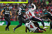 Houston Texan's quarterback, Deshaun Watson (4) slides into Texan's wide receiver, Deandre Carter (14) during the NFL game between Houston Texans and Jacksonville Jaguars at Wembley Stadium in London, United Kingdom. 03 November 2019
