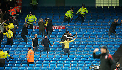MANCHESTER, ENGLAND - Sunday, February 13, 2010: Stoke City's supporters taunt the Manchester City fans as they score an equalising goal during the FA Cup 5th Round match at the City of Manchester Stadium. (Photo by David Rawcliffe/Propaganda)  MANCHESTER, ENGLAND - Sunday, February 13, 2010: Manchester City xxxx and Stoke City's xxxx during the FA Cup 5th Round match at the City of Manchester Stadium. (Photo by David Rawcliffe/Propaganda)