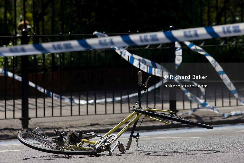 """The crushed wreckage of a ladies bike lies on the surface of the A3 Kennington Park Road at the junction with A23 Kennington Road, south London. A woman in her twenties was taken to King's College Hospital with a leg injury after a crash between a bus and a cyclist this morning. Emergency services were called to Kennington Park Road at 9.30am. A London Buses statement reads: ?At around 09:30 this morning a route 333 bus, operated by London General, was involved in a collision with a cyclist .."""""""