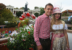 06.10.2013, Kaefers Wiesenschaenke, Muenchen, GER, der FC Bayern Muenchen beim Oktoberfest, im Bild Rafinha of Bayern Muenchen poses with Katja Butylina in front of the ensemble of the Bavaria statue, a monumental bronze sand-cast 19th-century statue and the Hall of Fame (Ruhmeshalle). The Bavaria is the female personification of the Bavarian homeland and by extension its strength and glory // during the Oktoberfest 2013 beer festival at Kaefers Wiesenschaenke in Munich, Germany on 2013/10/06. EXPA Pictures © 2013, PhotoCredit: EXPA/ Eibner/ Eckhard Eibner<br /> <br /> ***** ATTENTION - OUT OF GER *****