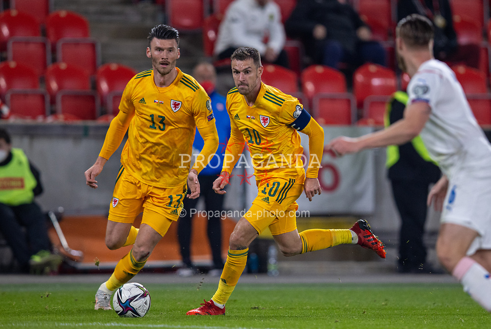 PRAGUE, CZECH REPUBLIC - Friday, October 8, 2021: Wales' captain Aaron Ramsey (R) and Kieffer Moore during the FIFA World Cup Qatar 2022 Qualifying Group E match between Czech Republic and Wales at the Sinobo Stadium. The game ended in a 2-2 draw. (Pic by David Rawcliffe/Propaganda)