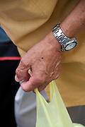 hand of an elderly person holding a plastic bag