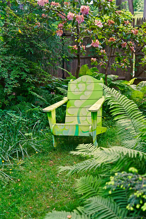 Painted chair sets among florals and ferns at Chanticleer Gardens, Wayne, PA