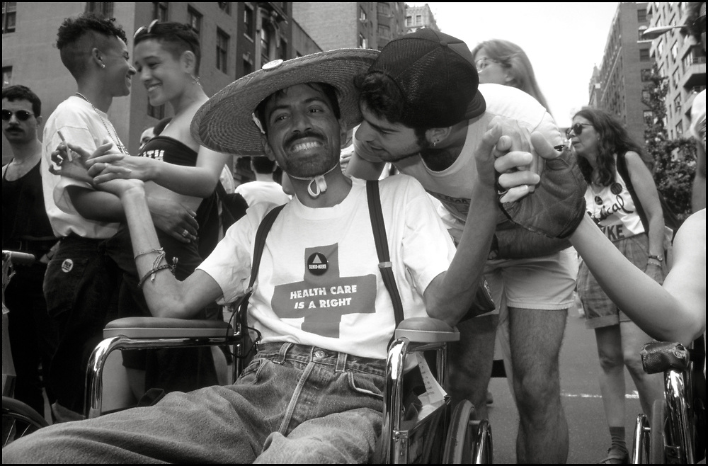 Ray Navarro, David Robinson, Lola Flash, Julie Tolentino, Natasha Gray and others members of ACT UP march in the Gay Pride Parade in New York City in June, 1990. <br /> <br /> Ray Navarro was an American video artist, filmmaker, and HIV/AIDS activist. Navarro was an active member of ACT UP and a founder of Diva TV. His activism was featured in the documentary How to Survive a Plague. Navarro's art was exhibited at the Institute of Contemporary Art, Boston, and in Pacific Standard Time: LA/LA. Ray Navarro died in November of 1990.