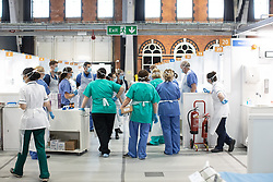 © Licensed to London News Pictures . 15/04/2020. Manchester, UK. Clinicians role play treating a patient in cardiac arrest on Ward 7 of the Nightingale NW Hospital . The National Health Service has built a 648 bed field hospital for the treatment of Covid-19 patients , at the historical railway station terminus which now forms the main hall of the Manchester Central Convention Centre . The facility is due to fully open this week (ending Friday 17th April 2020 ) and will treat patients from across the North West of England , providing them with general medical care and oxygen therapy after discharge from Intensive Care Units . Photo credit : Joel Goodman/LNP
