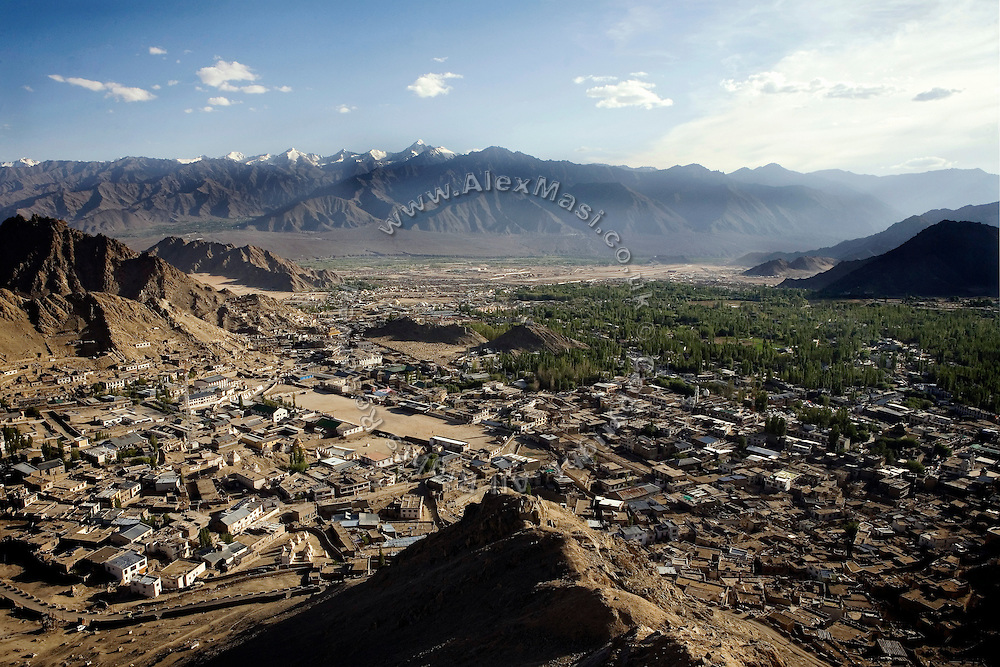 The town of Leh, capital of Ladhak, a small northern Himalayan Indian state with a dominant Buddhist population, is photographed from a nearby hill. ...The Leh-Manali Highway is the main road connection between the remote mountainous region of Ladhak, with capital in Leh (3300m), and Manali, HP, a famous hill station 600 km north of New Delhi. Open only four months a year, it is the second-highest motorable road in the world crossing passes up to 5300 meters. It was constructed by the Indian Army in order to develop the surrounding areas as well as monitoring the nearby borders with Kashmir and China. Due to its beauty and increased accessibility, the road to Leh and Ladhak has recently become a must-see destination for local and international tourists leaving the scorching Indian plains..