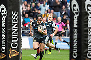 Liberty Stadium, Swansea, Wales, UK. Saturday 23 March 2019. Ospreys fullback Dan Evans celebrates on his way to scoring a try in the Guinness Pro14 rugby match between Ospreys and Dragons.