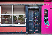 Faded elegance of a salon offering tattoo, piercing, body jewellery in Youghal, County Cork, Southern Ireland