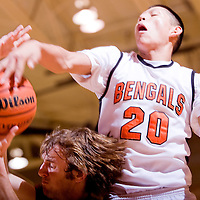 021213       Cable Hoover<br /> <br /> Gallup Bengal Darrien Spencer (20) blocks Belen Eagle Zach Martin (00) Tuesday at Gallup High School.