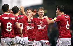 Bristol City's George Tanner (second right) celebrates with his team-mates after the Sky Bet Championship match at London Road, Peterborough. Picture date: Saturday October 2, 2021.